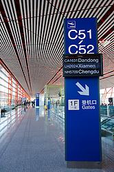 Modern departure gate signs inside new Terminal 3 at Beijing International Airport 2009