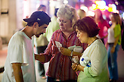 19 SEPTEMBER 2006 - NEW ORLEANS, LOUISIANA: MIREYA GROS, right, and LIZ ABADIE, center, from the Vieux Carre Assembly of God Church in the French Quarter pray with a passerby on Bourbon Street in New Orleans. Photo by Jack Kurtz / ZUMA Press