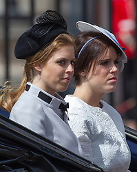 LONDON - UK - 15 JUNE 2013: Princesses Beatrice and Eugenie.<br /> Members of the British Royal Family join HM Queen Elizabeth for the annual Trooping The Colour Ceremony to mark the Queen's Official Birthday. The Queen and members of the family travelled by carriage to Horseguards for the ceremonial parade before joining her on the balcony of Buckingham Palace.<br /> The Duke of Edinburgh who normally accompanies the Queen was absent as he is still in hospital recovering from an operation.<br /> Photograph by Ian Jones.