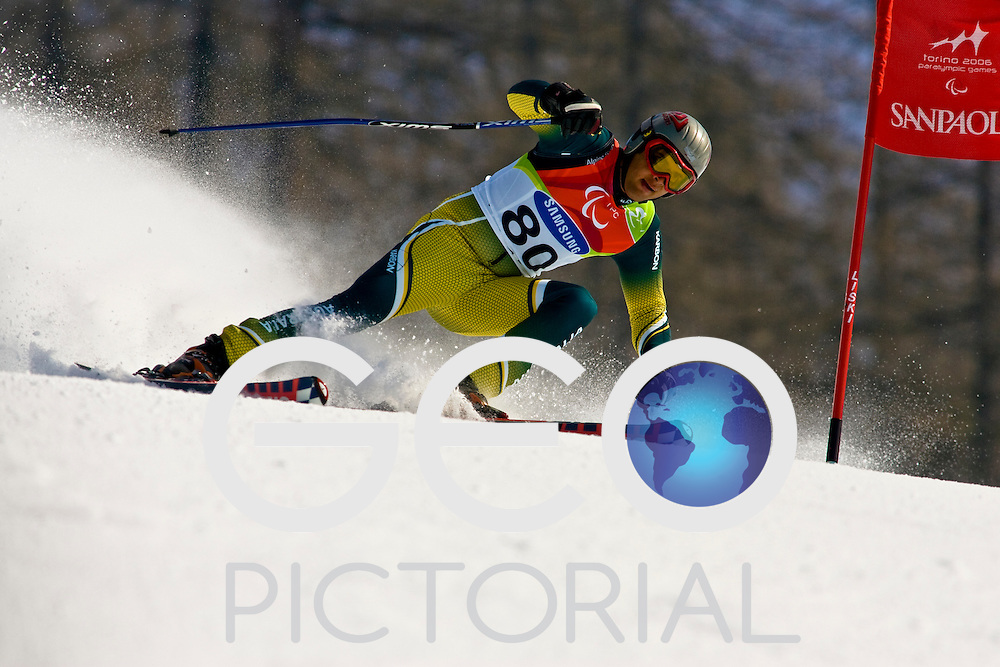 SESTRIERE COLLE, ITALY - MARCH  16th : Dean Calabrese (LW9-2) of Australia on his second run of the Mens Alpine Skiing Giant Slalom Standing competition on Day 6 of the 2006 Turin Winter Paralympic Games on March 16th, 2006 in Sestriere Borgata, Italy.