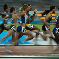 A slow shutter speed picture shows athletes compete in Women's 100M final (B) at Nanjing Olympic Sports Centre Stadium during Nanjing Youth Olympic Games  2014 in Nanjing, China, 23 August 2014. The Nanjing Youth Olympic  Games 2014 runs from from 16 to 28 August  2014.