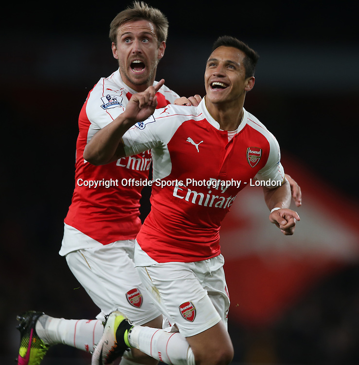 21 April 2016  Premier League Football - Arsenal v West Bromwich Albion :<br /> Alexis Sanchez celebrates his second gaol for Arsenal, with Nacho Monreal.<br /> Photo: Mark Leech