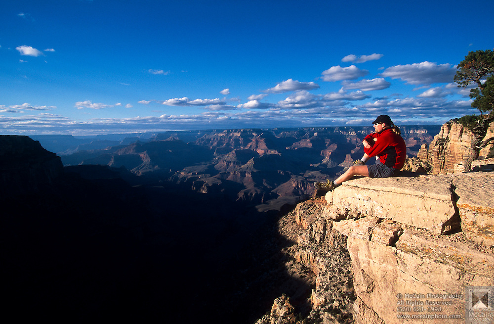 Hiker enjoys view from Yaki Point, top of South Kaibab Trail, Grand Canyon National Park, Arizona..Subject photograph(s) are copyright Edward McCain. All rights are reserved except those specifically granted by Edward McCain in writing prior to publication...McCain Photography.211 S 4th Avenue.Tucson, AZ 85701-2103.(520) 623-1998.mobile: (520) 990-0999.fax: (520) 623-1190.http://www.mccainphoto.com.edward@mccainphoto.com..