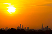 UNITED KINGDOM, London: 25 July 2019 <br /> The London skyline is cast in front of the sun as it rises on what could be the hottest day ever recorded in Britain. Temperatures are set to reach up to 39 degrees Celsius later today.<br /> Rick Findler / Story Picture Agency