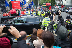 """London, UK. 25 September, 2019. Pro- and anti-Brexit activists protest as MPs arrive at the House of Commons on the day after the Supreme Court ruled that the Prime Minister's decision to suspend parliament was """"unlawful, void and of no effect""""."""