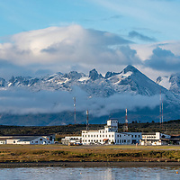 View of buildings and mountain range in the town of Ushuaia, known as the End of the World or Fin del Mundo, on the Beagle Channel in Argentina.