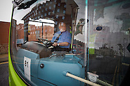 A driver at a bus stop during the Bus Driver of the Year competition in Blackpool. The event, first staged in 1967, attracted 105 entrants from across the United Kingdom who completed theory and practical driving test to determine who would win the 2013 award.