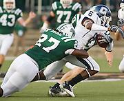 Ohio Linebacker Erikk Ejike tackles UConn's Jasper Howard in the backfield on Saturday, September 5, 2009.