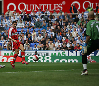 Photo: Lee Earle.<br /> Reading v Middlesbrough. The Barclays Premiership. 19/08/2006. Middlesbrough's Stewart Downing beats Reading keeper Marcus Hahnemann to open the scoring.