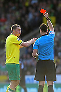 Picture by Paul Chesterton/Focus Images Ltd.  07904 640267.24/03/12.Grant Holt of Norwich is sent off by Referee Mark Clattenburg for a 2nd yellow card offence after his foul on Michael Kightly of Wolves during the Barclays Premier League match at Carrow Road Stadium, Norwich.