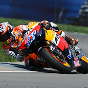 28 August 2011: Moto GP Repsol Honda Team rider Casey Stoner (27) navigates turn 11 during the Red Bull Indianapolis Gran Prix MOTO GP at the Indianapolis Motor Speedway in Indianapolis, IN..