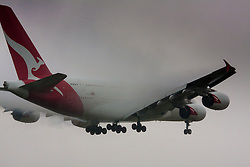"January 3rd 2015, Heathrow Airport, London. Low cloud and rain provide ideal conditions to observe wake vortexes and ""fluffing"" as moisture condenses over the wings of landing aircraft. With the runway visible only at the last minute, several planes had to perform a ""go-round"", abandoning their first attempts to land. PICTURED: Water vapor condesnses over the wings of a Qantas Airbus A380 as it prepares to land on Heathrow's runway 27L."