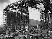 The White Star Line vessels Olympic and Titanic under constructionin Harland and Wolff's shipyard, Belfast, Northern Ireland, 1909-1911.