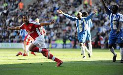 Theo Walcott of Arsenal celebrates after scoring to make it 1-1