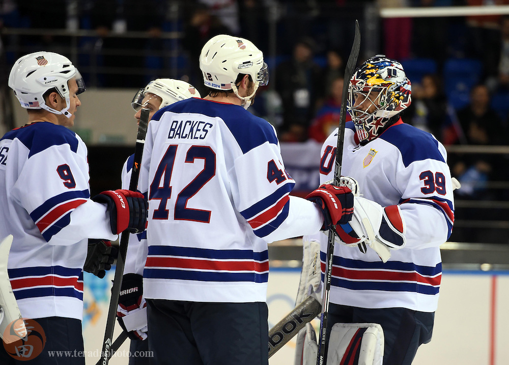 Feb 16, 2014; Sochi, RUSSIA; USA goalie Ryan Miller (39) celebrates with teammates Zach Parise (9) and David Backes (42) after defeating Slovenia in a men's ice hockey preliminary round game during the Sochi 2014 Olympic Winter Games at Shayba Arena.