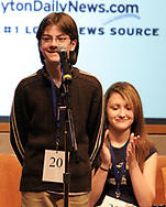 Ellyn Caroline Polander (right), from St. Luke, claps to congratulate Daniel Grigg (left,) from St. Albert the Great, as it's announced he won at the 2007 Regional Spelling Bee, at Sinclair Community College, Saturday morning.