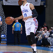 Delaware 87ers Guard Gideon Gamble (19) dribbles the ball down court in the first half of a NBA D-league regular season basketball game between the Delaware 87ers and the Erie BayHawk (Orlando Magic) Friday, Mar. 27, 2015 at The Bob Carpenter Sports Convocation Center in Newark, DEL.