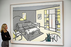 "© Licensed to London News Pictures. 27/09/2019. LONDON, UK.  A staff member views ""Modern Room (Study)"", 1996, by Roy Lichtenstein (Est. GBP 0.5-0.7m).  Preview of Sotheby's Frieze Week Contemporary Art exhibition at its New Bond Street galleries.  Over 250 works by artists, including Andy Warhol, David Hockney and Jean-Michel Basquiat, will be auctioned on 3 October 2019.  Photo credit: Stephen Chung/LNP"