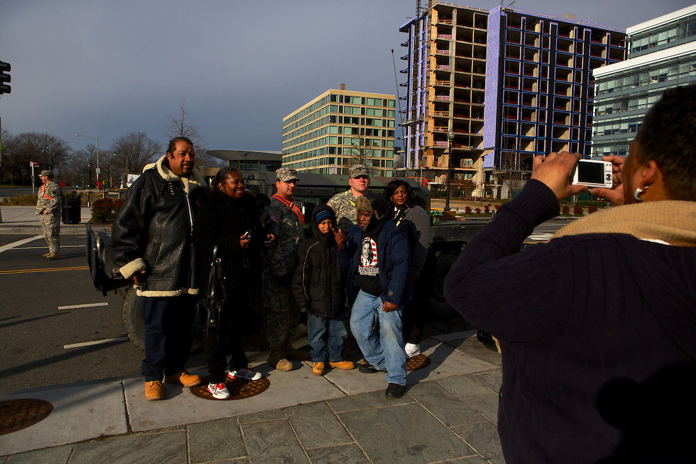 Pedestrians have their photo taken with members of the military near the waterfront before the inauguration ceremony for Pres. Barack Obama on January 21, 2013 in Washington, D.C.