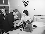 Image of Fianna Fáil leader Charles Haughey touring West Cork during his 1982 election campaign...04/02/1982.02/04/82.4th February 1982..Being patient:..While there he visits Clonakilty County Hospital and is photographed speaking to Mrs Mary O'Mahoney and her 1 year old daughter, Fiona...