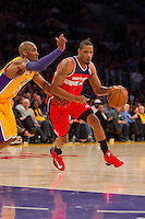 22 March 2013: Forward (1) Trevor Ariza of the Washington Wizards drives to the basket while being guarded by (24) Kobe Bryant of the Los Angeles Lakers during the first half of the Wizards 103-100 victory over the Lakers at the STAPLES Center in Los Angeles, CA.