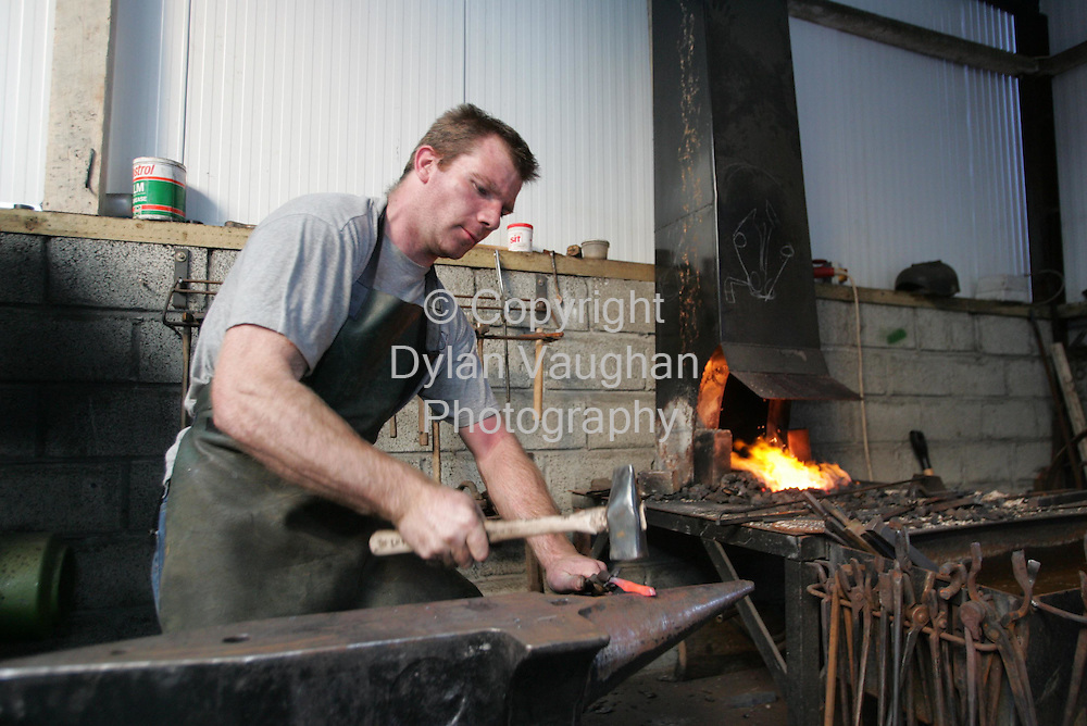 8/9/2004.Jack Carey pictured at work at the Carey family home in Gowran County Kilkenny..Picture Dylan Vaughan