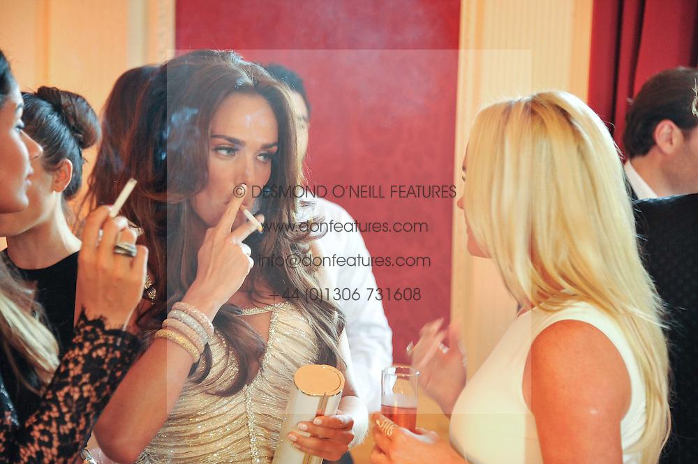 TAMARA ECCLESTONE smoking at a party to celebrate Tamara Ecclestone's 28th birthday held in Tyringham, Newport Pagnell, Bucks on15th June 2012.