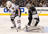 Kings' goaltender Jonathan Quick makes a save in front of the Blackhawks' Marcus Kruger during Los Angeles' 5-2 victory over the Chicago Blackhawks in Game 4 of the Western Conference Final of the 2014 NHL Stanley Cup Playoffs at Staples Center Monday.