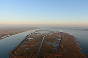 "Nederland, Zuid-Holland, Haringvliet, 07-02-2018; overzicht van het eiland Tiengemeten. Het eiland werd oorspronkelijk gebruikt voor de akkerbouw maar is inmiddels 'teruggegeven aan de natuur', de dijken zijn deels doorgestoken, de laatste boer is in 2006 vertrokken. De 'nieuwe natuur' vormt onderdeel van de Ecologische Hoofdstructuur.<br /> The island Tiengemeten in the Haringvliet, was originally used for agriculture but has now ""been given back to nature"". Large parts have been flooded and the isle is part of the National Ecological Network. The last farmer left in 2006. Current use, among other, care farm and camping. <br /> luchtfoto (toeslag op standard tarieven);<br /> aerial photo (additional fee required);<br /> copyright foto/photo Siebe Swart"