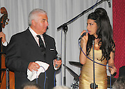 20.JUNE.2010. LONDON<br /> <br /> AMY WINEHOUSE JOINS HER DAD MITCH WINEHOUSE ON STAGE AS HE PERFORMS A LOW KEY GIG AT PIZZA ON THE PARK ON HYDE PARK CORNER. HIS GIG WAS ATTENDED BY HIS DAUGHTER AMY AND NEW BOYFRIEND REG TRAVISS, DIONNE BROMFIELD AND TONY HILLER.THIS WAS TO BE THE LAST GIG AT PIZZA ON THE PARK AS IT CLOSING DOWN TO BECOME A NEW BOUTIQUE HOTEL.<br /> <br /> BYLINE: OPTICPHOTOS.COM<br /> <br /> *THIS IMAGE IS STRICTLY FOR UK NEWSPAPERS AND MAGAZINES ONLY*<br /> *FOR WORLD WIDE SALES AND WEB USE PLEASE CONTACT OPTICPHOTOS - 0208 954 5968*