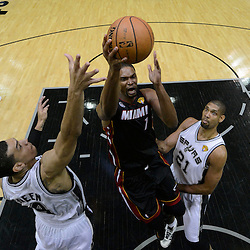 Jun 13, 2013; San Antonio, TX, USA; Miami Heat center Chris Bosh (1) drives to the basket against San Antonio Spurs shooting guard Danny Green (4) during the first half of game four of the 2013 NBA Finals at the AT&T Center. Mandatory Credit: Derick E. Hingle-USA TODAY Sports