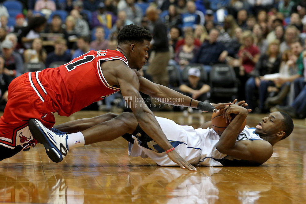 Nov 1, 2014; Minneapolis, MN, USA; Minnesota Timberwolves guard Andrew Wiggins (22) dives for a loose ball with Chicago Bulls guard Jimmy Butler (21) during the third quarter at Target Center. The Bulls defeated the Timberwolves 106-105. Mandatory Credit: Brace Hemmelgarn-USA TODAY Sports