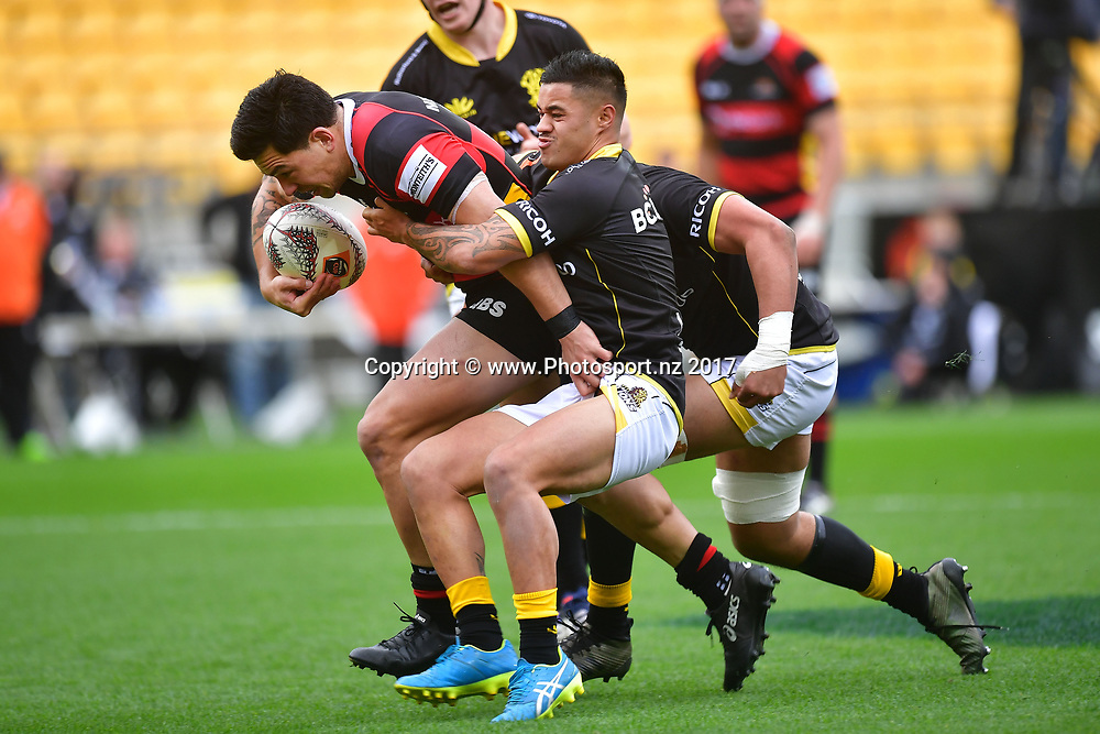 Canterburys Rob Thompson (L) is tackled by Lions Kemara Hauiti-Parapara (C and Teariki Ben-Nicholas during the Mitre 10 Cup rugby match between  Wellington and Canterbury at Westpac Stadium in Wellington on Sunday the 17th September 2017. Copyright Photo by Marty Melville / www.Photosport.nz
