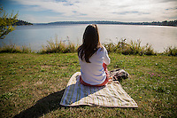 Seattle, Washington- October 2, 2014: A woman relaxes on a sunny day in Seward Park. The park encompasses all of Bailey Peninsula, which juts into Lake Washington, and contains some of the last old growth conifer forest within the city of Seattle. CREDIT: Chris Carmichael for the New York Times