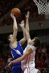12 January 2013: Jon Ekey goes up to block a shot offered by Micah Mason during an NCAA Missouri Valley Conference mens basketball game Where the Bulldogs of Drake University beat the Illinois State Redbirds 82-77 in Redbird Arena, Normal IL