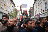 Subject: Broad Street, Worcester, Worcestershire, UK. 21st July 2018. Up to 40 English Defence League supporters took to the streets of Worcester to protest against a proposed new mosque building in the city. Scores of police formed a barrier in Broad Street between English Defence League supporters and approximately 200 vocal counter-protesters comprising of students, trade union members, local councillors and members of the local muslim community. Skirmishes broke out between the counter-protesters, police and EDL supporters with a number of injuries and arrests made. Pictured: Counter-demonstrators shout slogans and gesture to a small contingent of EDL supporters.  // Lee Thomas, Tel. 07784142973. Email: leepthomas@gmail.com www.leept.co.uk