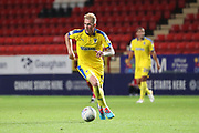 AFC Wimbledon midfielder Mitchell (Mitch) Pinnock (11) dribbling during the EFL Trophy match between Charlton Athletic and AFC Wimbledon at The Valley, London, England on 4 September 2018.