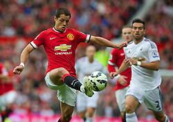 16.08.2014, Old Trafford, Manchester, ENG, Premier League, Manchester United vs Swansea City, 1. Runde, im Bild Manchester United's Javier Hernandez in action against Swansea City // 15054000 during the English Premier League 1st round match between Manchester United and Swansea City AFC at Old Trafford in Manchester, Great Britain on 2014/08/16. EXPA Pictures &copy; 2014, PhotoCredit: EXPA/ Propagandaphoto/ David Rawcliffe<br /> <br /> *****ATTENTION - OUT of ENG, GBR*****