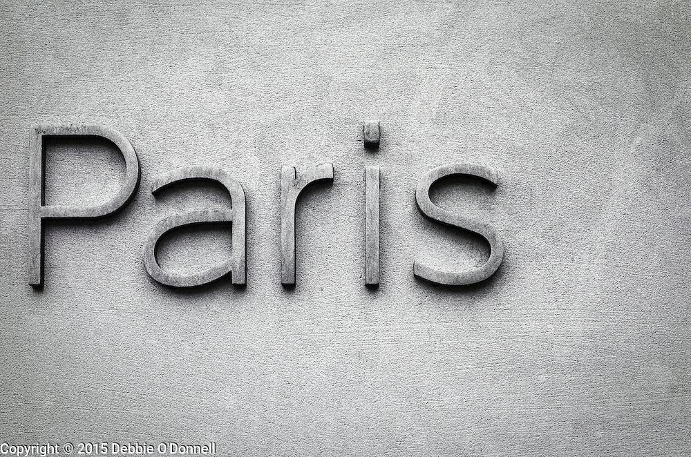 'Paris' on the wall of a building on the Avenue des Champs-Élysées.