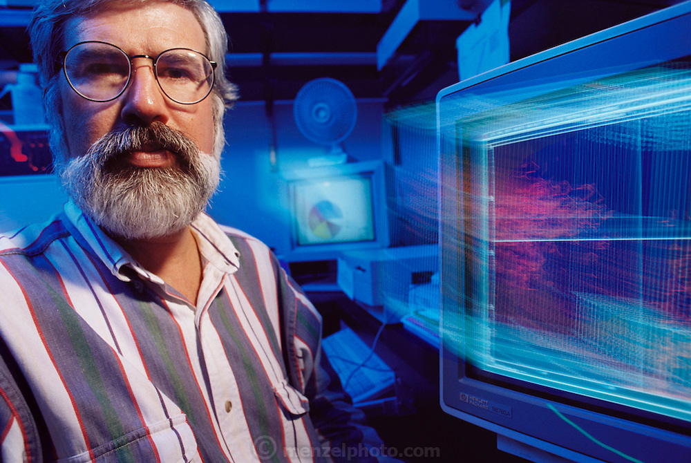 MODEL RELEASED. Immunodeficiency research. Dr Don Mosier counts mouse and human cells in a SCID (severe combined immunodeficiency) mouse that he implanted with a human immune system. The device at right is a fluorescence-activated cell sorter. The rare genetic mutation of SCID, found in both mice and humans, destroys the immune system and the body is unable to fight infection. Dr Mosier managed to implant disease-fighting human white blood cells into SCID mice giving them a permanent human immune system. This breakthrough enables researchers at the Scripps Research Institute in California, USA, to study human immune disorders such as SCID, AIDS, leukemia and allergies. MODEL RELEASED.[1995]