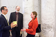 Annapolis, Maryland - May 12, 2015: Robin Dutta, representative for Maryland DC Virginia Solar energy industries association (MDV-SEIA), left, David O'Leary with Maryland Sierra Club, middle, and Jessica Ennis, Earthjustice legislative representative celebrate after the signing of the community solar bill at the Maryland State House in Annapolis Tuesday May 12, 2015. <br /> <br /> CREDIT: Matt Roth for Earthjustice