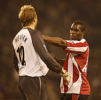 Photo: Aidan Ellis.<br /> Sheffield United v Manchester City. The Barclays Premiership. 26/12/2006.<br /> Sheffield's Christian Nade pushes City keeper Nicky weaver