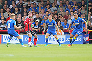 AFC Wimbledon midfielder Jake Reeves (8), AFC Wimbledon defender & captain Barry Fuller (2) and AFC Wimbledon defender Darius Charles (32) during the EFL Sky Bet League 1 match between AFC Wimbledon and Shrewsbury Town at the Cherry Red Records Stadium, Kingston, England on 24 September 2016. Photo by Stuart Butcher.