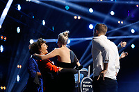 Wolf Alice walk towards the stage to accept their Mercury Prize