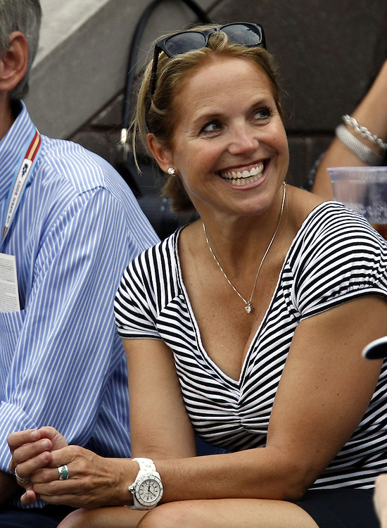 US TV anchor Katie Couric  watches Roger Federer of Switzerland play Novak Djokovic of Serbia during the men's final on the last day of the 2007 US Open tennis tournament in Flushing Meadows, New York, USA, 09 September 2007.