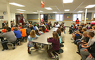 Dennis Washburn of Cedar Rapids talks to a group of third grade kids before the start of the dictionary giveaway by Cedar Rapids Elks Lodge #251 at Prairie Crest Elementary School in Cedar Rapids on Monday, November 5, 2012.