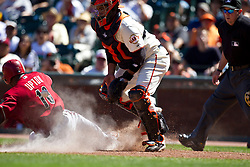 May 30, 2010; San Francisco, CA, USA;  Arizona Diamondbacks right fielder Justin Upton (10) scores a run in front of San Francisco Giants catcher Bengie Molina (1) during the eighth inning at AT&T Park.
