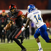 20 October 2018: San Diego State Aztecs wide receiver Fred Trevillion (7) stiff arms San Jose State Spartans safety Bobby Brown II (14) after making a catch for a first down late in the second quarter. The Aztecs beat the Spartans 16-13 Saturday night at SDCCU Stadium.