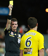 Wellington Phoenix's Tim Brown is shown a yellow card against the Perth Glory during the A-Leagues minor semi final held at nib Stadium, Perth, Australia on Saturday 7 April 2012. Photo Theron Kirkman / Photosport.co.nz