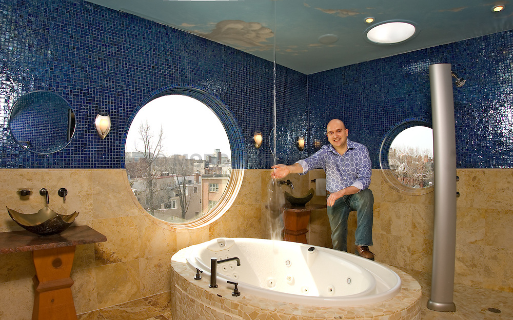 Master Bathroom Salvador Dali master bath with round tub water spouts from ceiling at the Artist Inn Washington DC